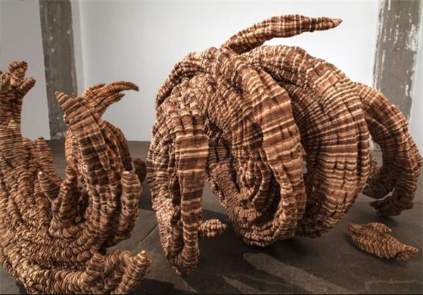 تصاویر دیدنی عکس و کلیپ  , مجسمه هایی از صدها قطعه چوب