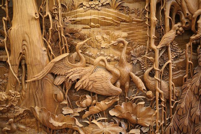 منبت کاری های بی نظیر و دیدنی روی چوب - مجسمه چوبی