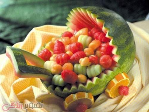 تزیین هندوانه شب یلدا به شکل کالسکه