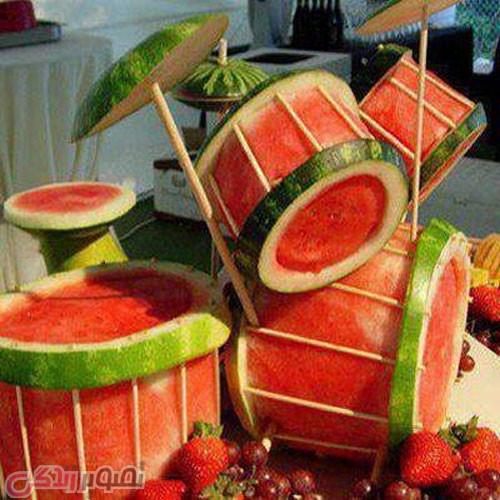 تزیین هندوانه شب یلدا به شکل پرکاشن