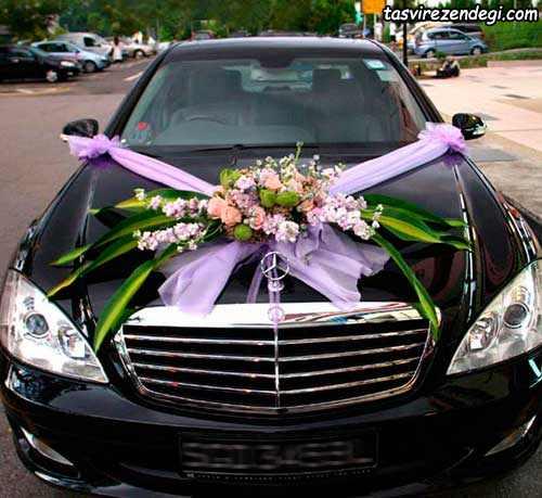 تزیین ماشین عروس مشکی با گل و تور
