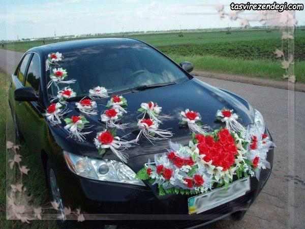 تزیین ماشین عروس مشکی با تور و گل