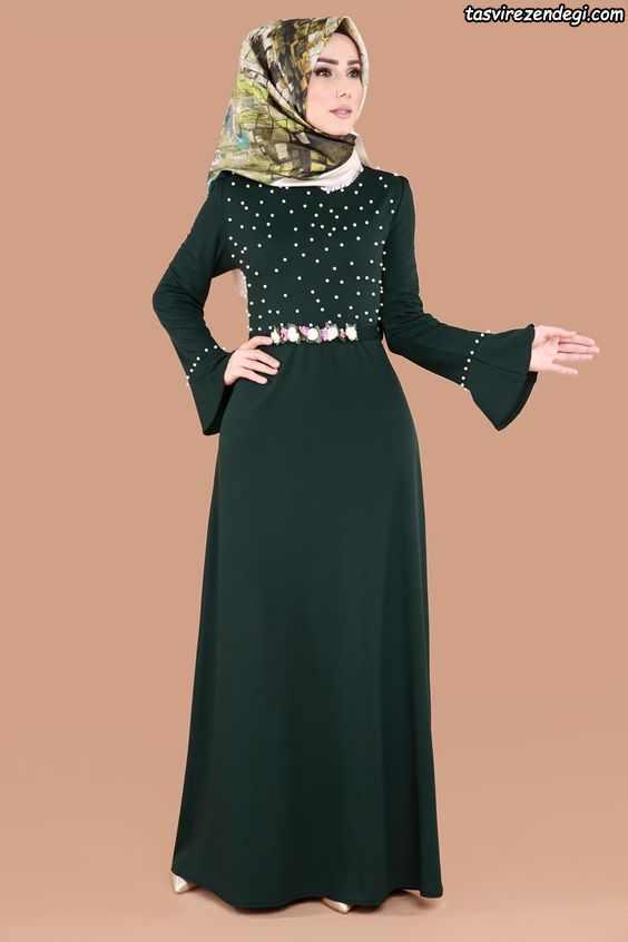 لباس مجلسی پوشیده سبز تیره مروارید دوزی شده