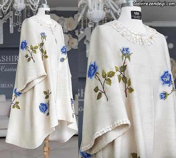 مانتو شنلی زمستانی سفید با گلهای آبی برجسته