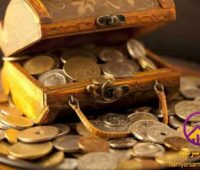 a box full of gold coins